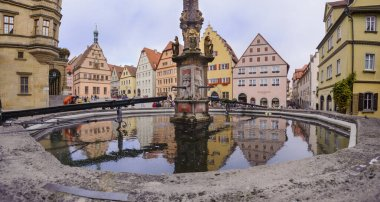Panoramic view of the medieval old town of Rothenburg with beautiful shops in historic half-timbered houses.