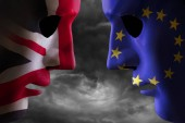 Brexit concept showing two heads together covered in EU flag and UK flag with storm clouds behind. Political graphic concept artwork.
