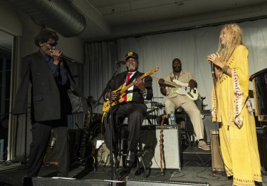 New York, NY - October 13, 2018: Charlie Sayles and Wendy Oxenhorn perform with The Blues at Loft Party A Night for the Soul for Jazz Foundation of America at Hudson Studios, Manhattan