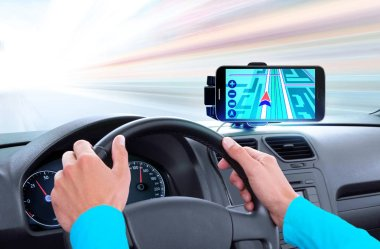navigator on dashboard and hands of driver that sits on driver's seat