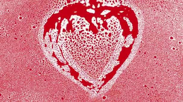 Červené srdce tvar od cákanců a kuličky