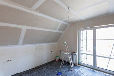 Empty bedroom interior with gypsum board ceiling at renovation