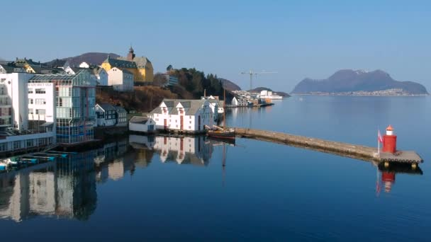 Alesund, Norway - April 14, 2018: Beautiful architecture of Alesund town at sunny day in Norway. Alesund is a popular tourist destination in Norway