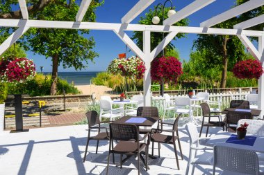 Beautiful white terrace in the garden by the sea