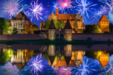 Malbork castle over the Nogat river at night, Poland
