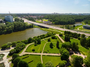 Bridge across a large city pond and Victory Park in Zelenograd Russia.
