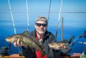 Fotografie Šťastný rybář s rybářských trofejí