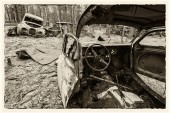 Retro cars cemetery in retro styled picture