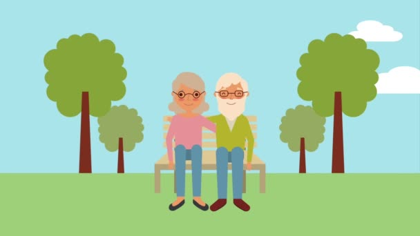 elderly couple sitting on bench in the park