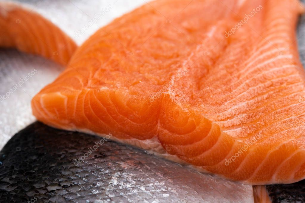 Raw salmon filets on close upe as background
