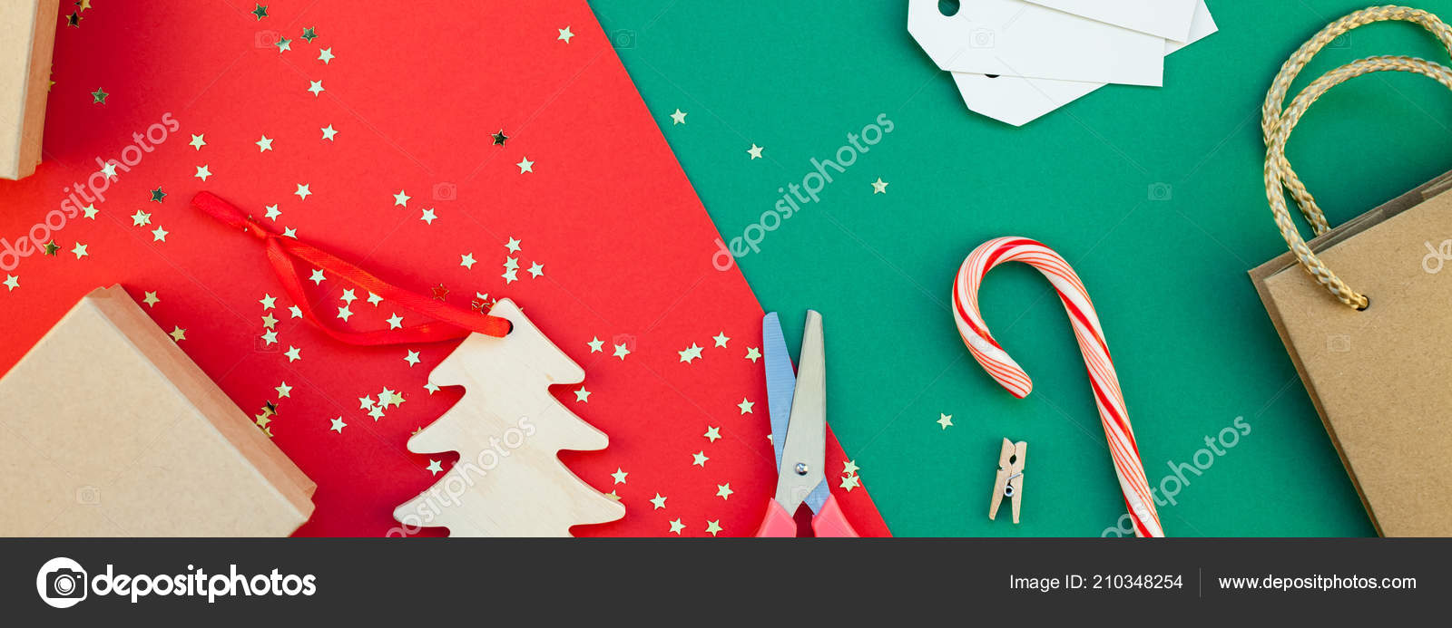 new year or christmas presents preparation diy flat lay top view xmas holiday celebration handmade gift boxes on red green paper background