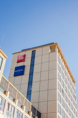 MUNICH, GERMANY - DECEMBER 26, 2018: Novotel suites and Ibis logos at hotel building located in Munich, Germany