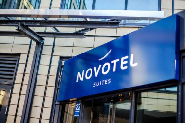 MUNICH, GERMANY - DECEMBER 26, 2018: Novotel suites logo at hotel building located in Munich, Germany
