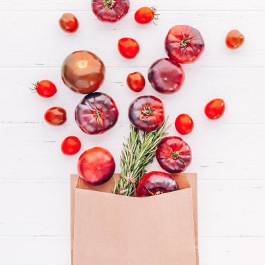 Creative flat lay top view mockup of exotic spanish made tomatoes Mar Azul on white wooden table background copy space. Minimal house cooking concept mock up for blog or recipe book