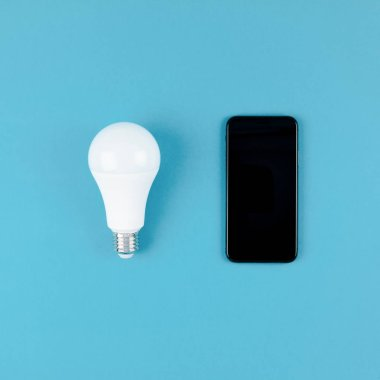LED light bulbs and modern smartphone mockup