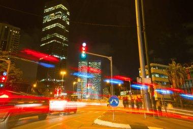Tel Aviv At Night, Skyscraper Construction Sites and traffic In Tel aviv