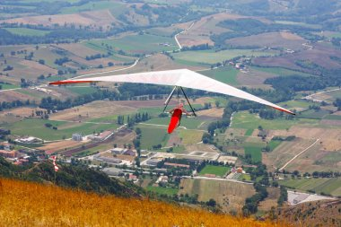 Hang glider pilot in Italian mountains
