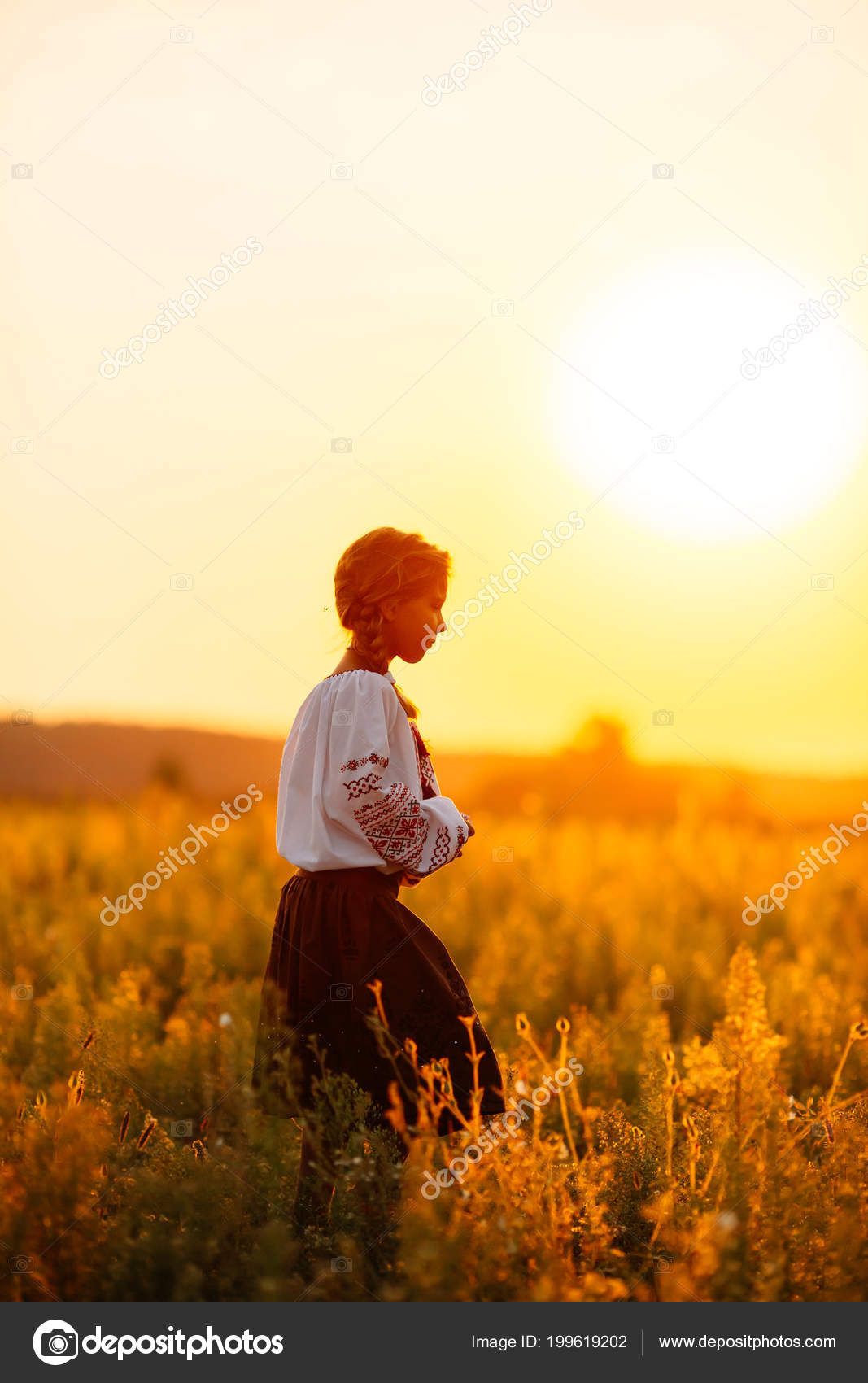 A girl in embroidered clothes walking along the field in the background of  the setting sun Concept of countryside lifestyle, national traditions —  Photo by ...