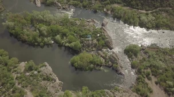 Aerial view to granite mountains and rapids on Southern Bug river , Mihiia village. Ukraine. Famous place for rafting and kayaking