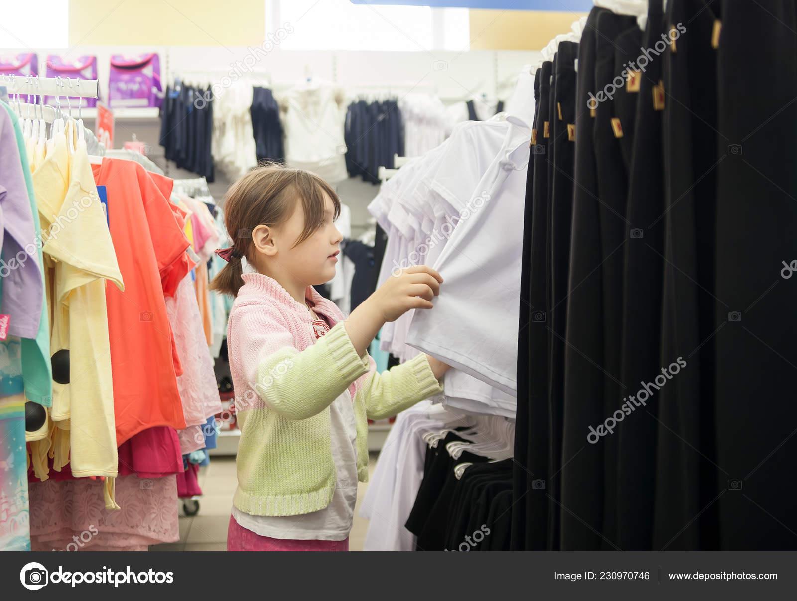 41f447f3e26 Girl Year Old Children Clothing Store Choosing School Uniform — Stock Photo
