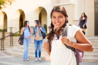Cute Hispanic Teen Girl Student Walking on School Campus.