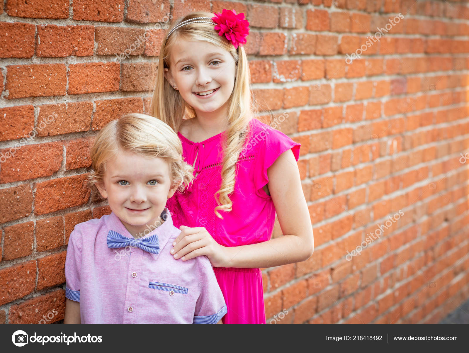 Cute Young Caucasian Brother Sister Portrait Stock Photo