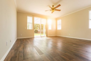 Empty Room of New House With Hard Wood Floors.