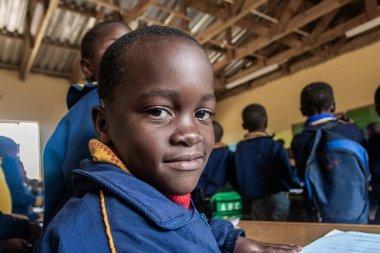 PIGGS PEAK, SWAZILAND-JULY 29: Unidentified orphan students on July 29, 2008 in Nazarene Mission School, Piggs Peak, Swaziland. stock vector