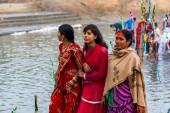 RAXAUL, INDIA - NOV 8: Unidentified Indian women celebrating Chhath on Nov 8, 2013 in Raxaul, Bihar state, India.