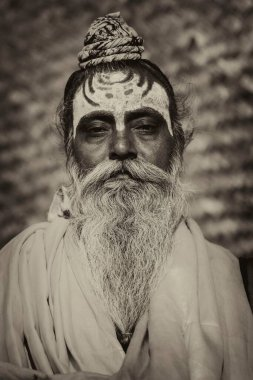 Portrait of a bearded Sadhu man with painted forehead