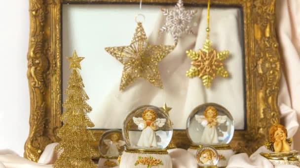 Footage of Christmas  snow globe angels and frame decorations for the advent season