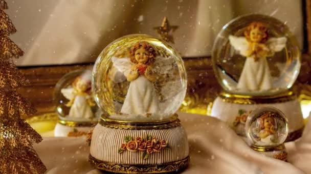 Footage of Christmas snow globe angel decoration for the advent season