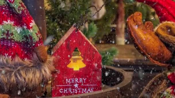 Video of Merry Christmas red wooden house decoration for the advent season with snowfall effect