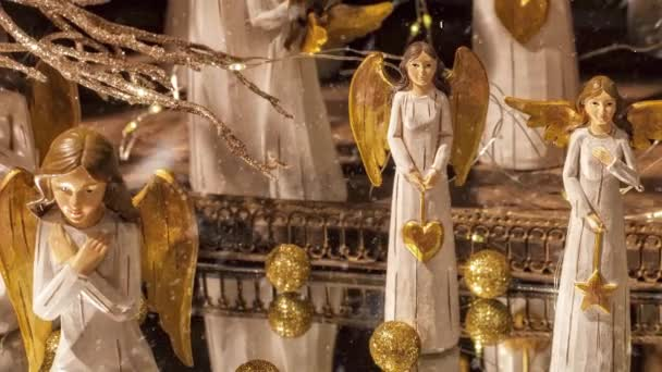Video of Christmas angels with golden wings decoration for the advent season with snowfall effect