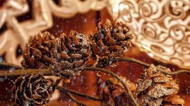 Video of snowy pine cones Christmas decoration for the advent season with snowfall effect
