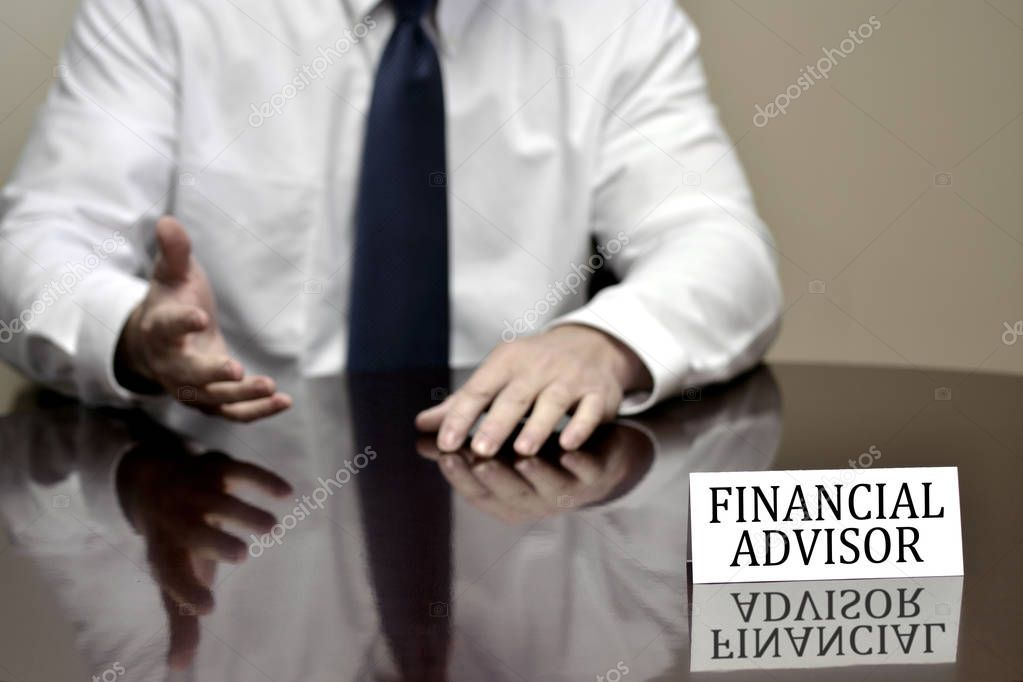 Financial advisor man business businessman at desk with sign helping finances
