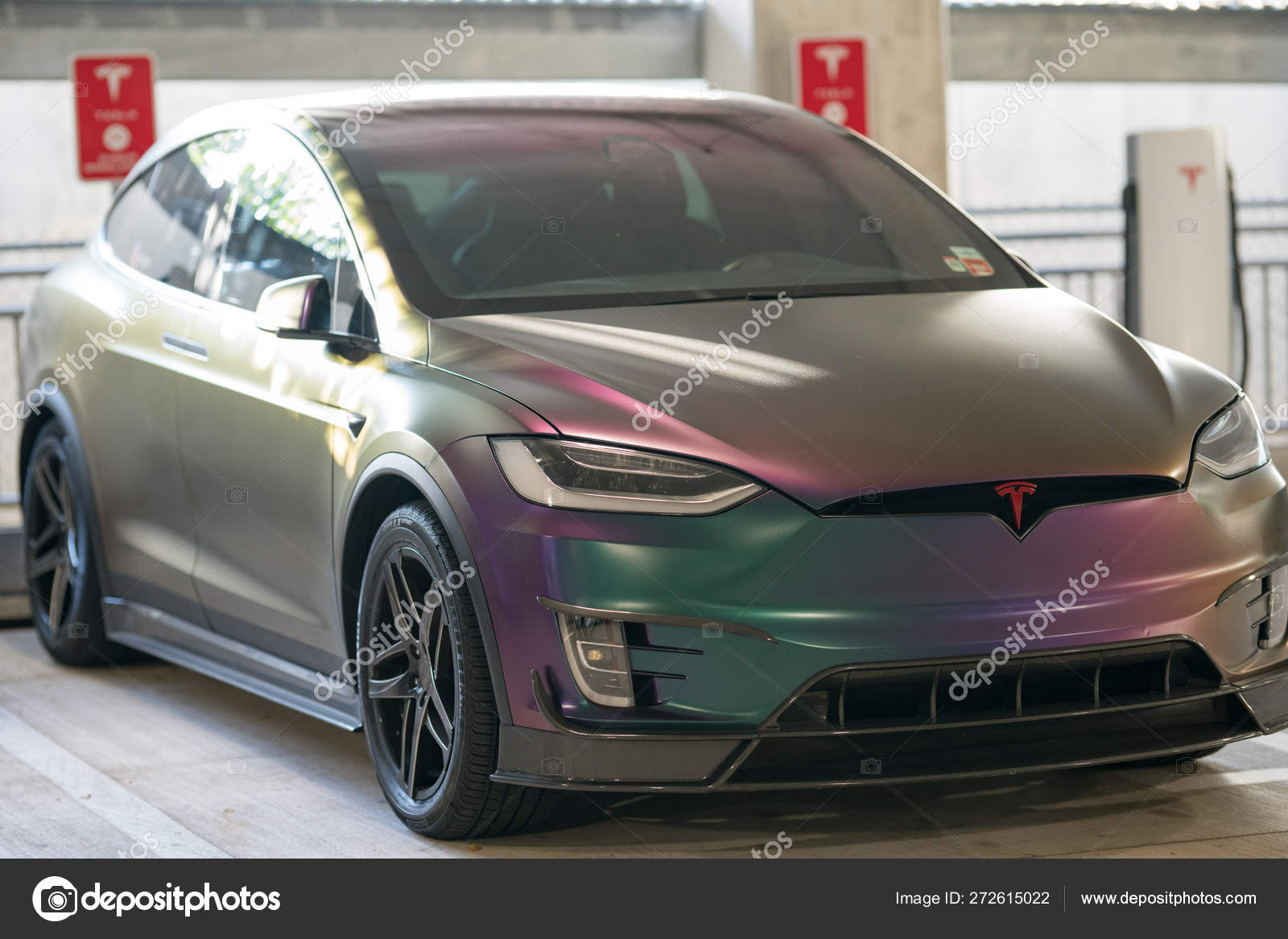 Tesla Model x with galaxy color wrapping paint – Stock Editorial
