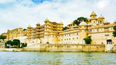 City Palace complex seen from Lake Pichola, Udaipur, Rajasthan, India stock vector