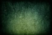 Fotografie Abstrakte dunkelgrüne Farbe Textur Hintergrund mit radialen Farbverlauf