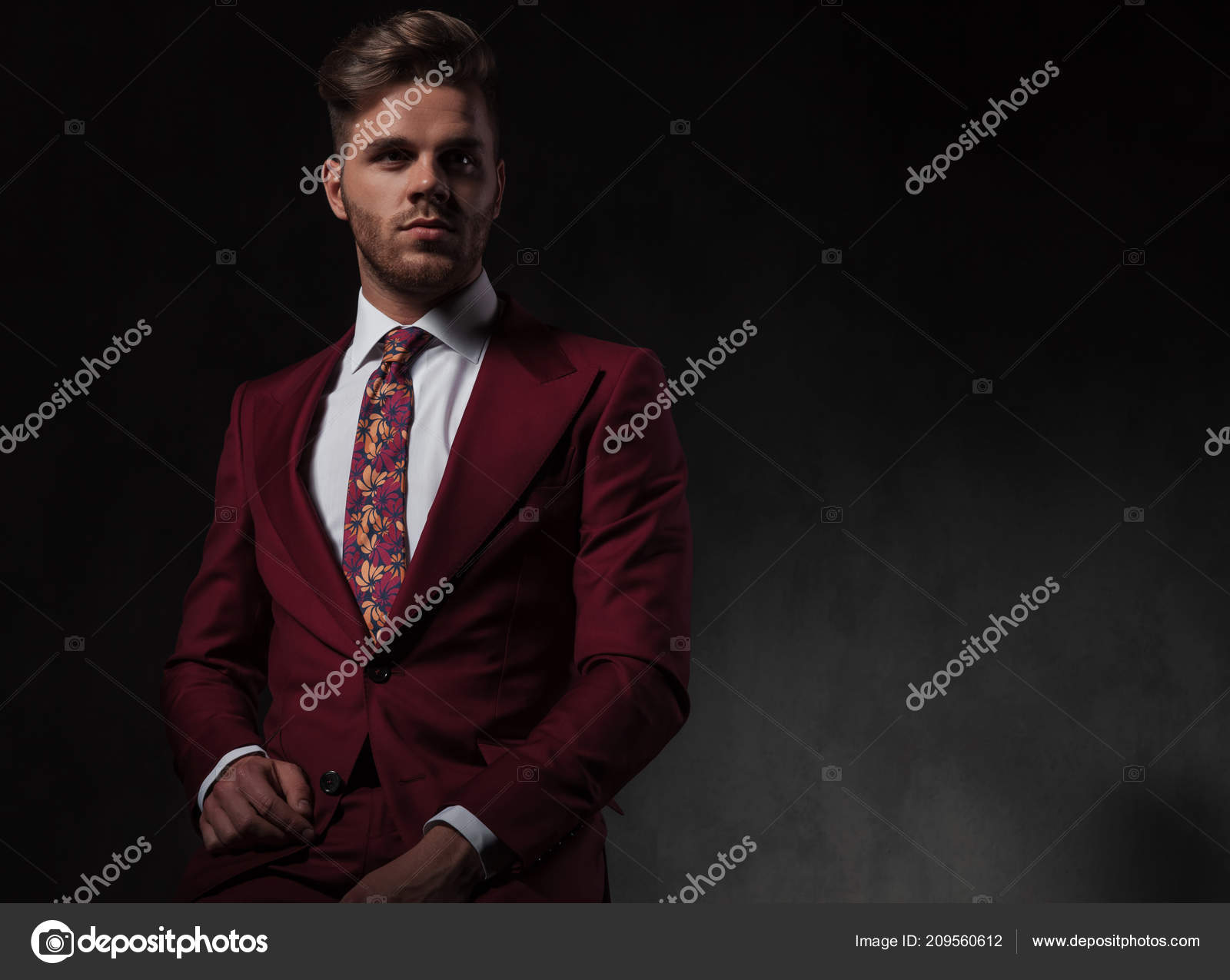 Portrait Handsome Stylish Man Red Suit Sitting Grey