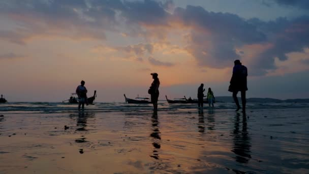 Silhouette of people  at Sunset in Ao Nang Krabi province Thailand