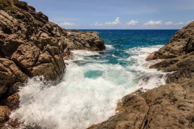 Tide in small rocky cove on island, British Virgin Islands