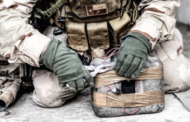 Soldier cuts wire on improvised explosive device