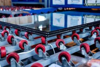 Conveyor belt for production a window pane. Industrial equipment. Background