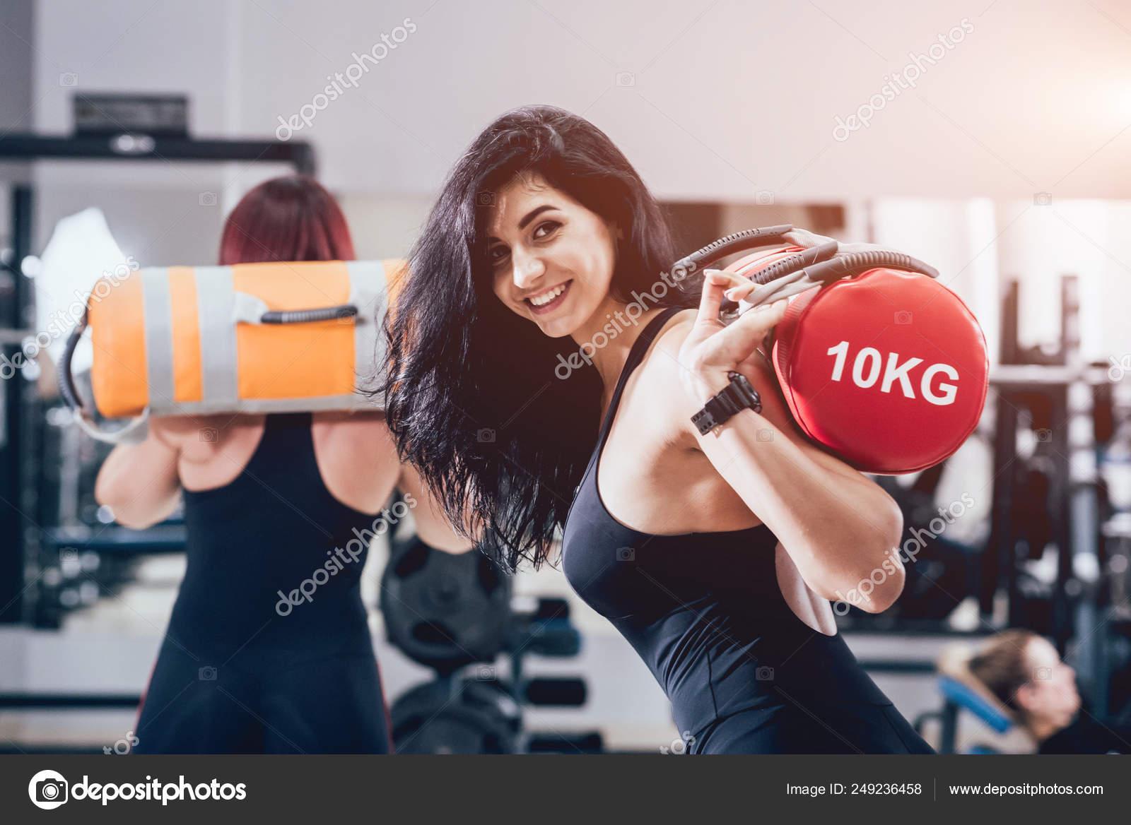 Athletic Young Women Training Sandbags Gray Background Cross Training  Fitness — Stock Photo © Romaset #249236458