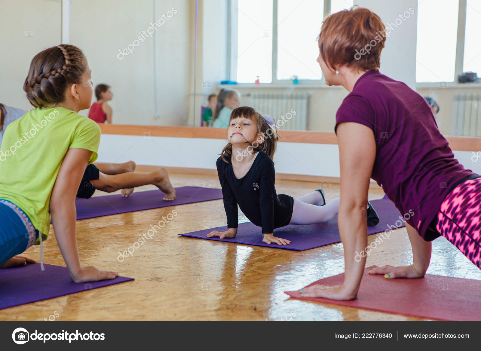 Yoga lesson for kids with teacher in a room – Stock