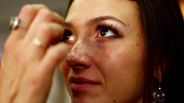 Make-up artist working in studio.