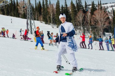 Sheregesh, Kemerovo region, Russia - April 7, 2018: Grelka Fest is a sports and entertainment activity for ski and snowboard riders in carnival costume. Young people in carnival costumes.
