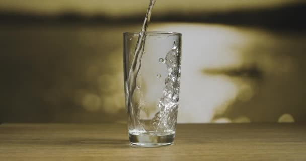 pouring water in glass slow motion