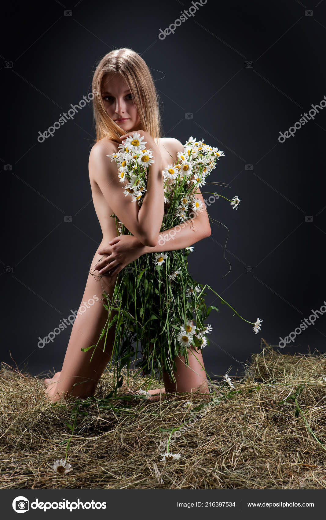 Mine Young nude in hay